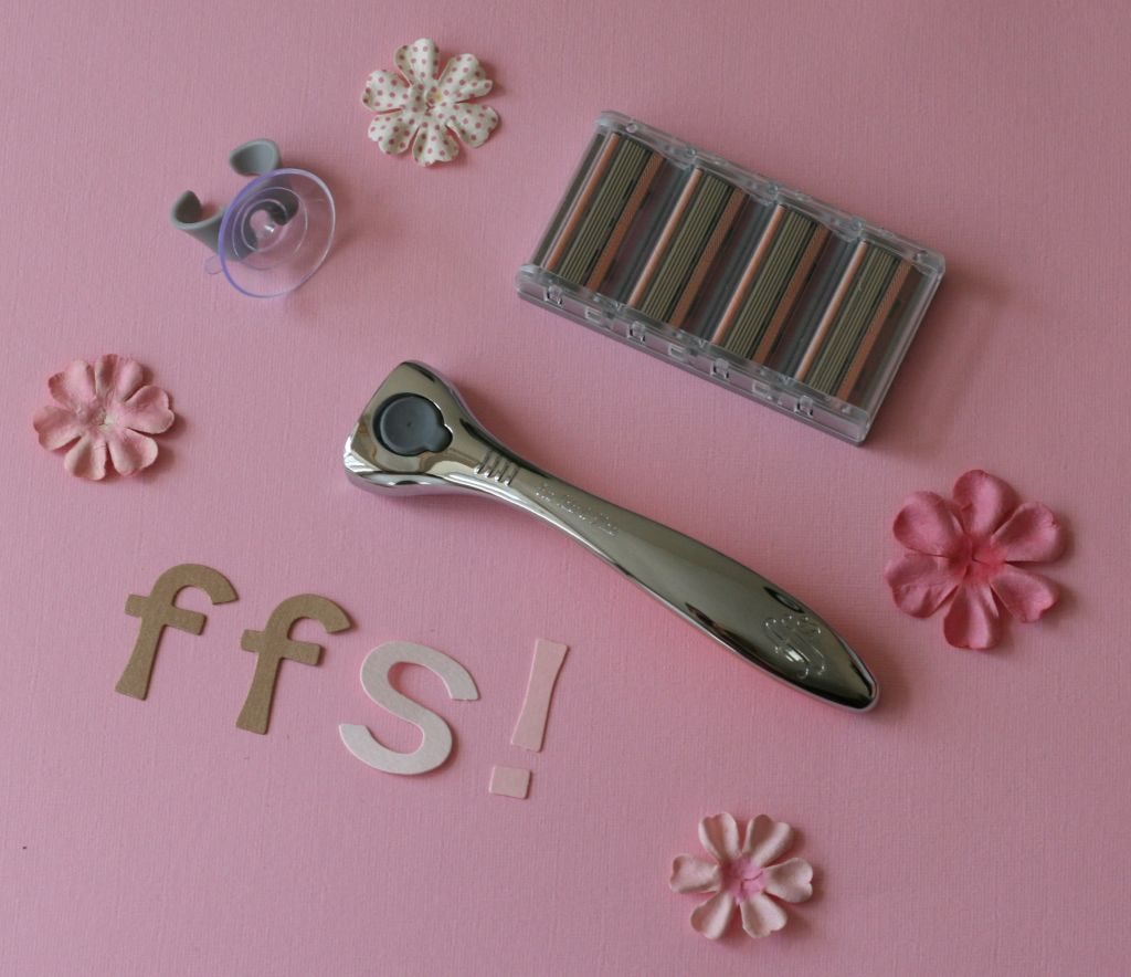 Friction free shaving razor and blades with flowers and pink background